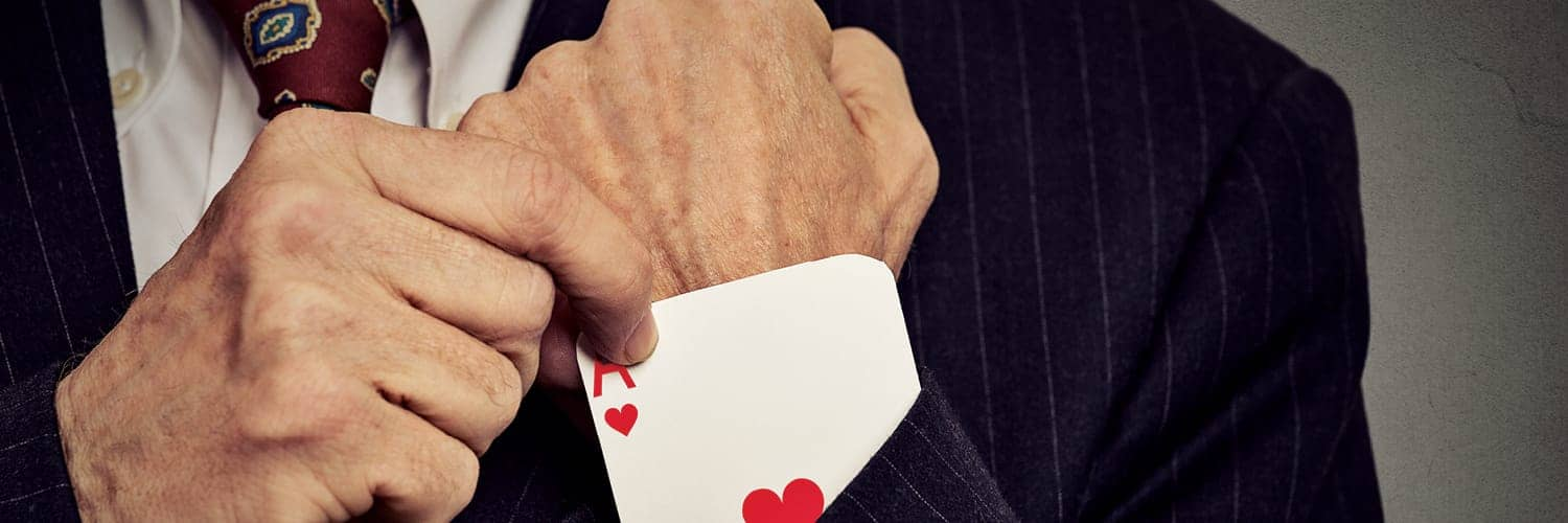 enhance customer experience - a man pulling an ace of hearts out of his sleeve